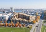 ビャルケ・インゲルス/BIGによるストックホルムの集合住宅。3.6mx3.6mのプレハブ式住戸で構成。階段状のカスケードデザインは採光と眺望を最適化する